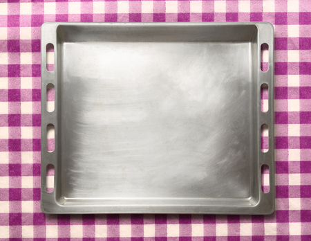 oven tray: Empty metal oven tray on lilac background