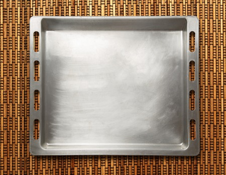 oven tray: Empty metal oven tray on rod background