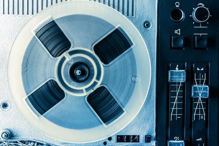 turn dial: Old reel tape recorder in toning closeup
