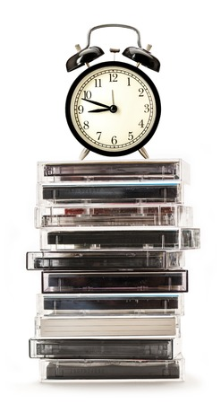 cassettes: Stack of old cassettes and alarm clock