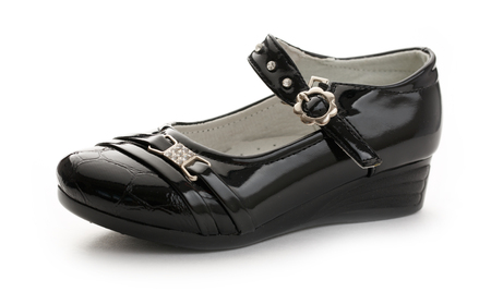 Girls black classic shoe on white background