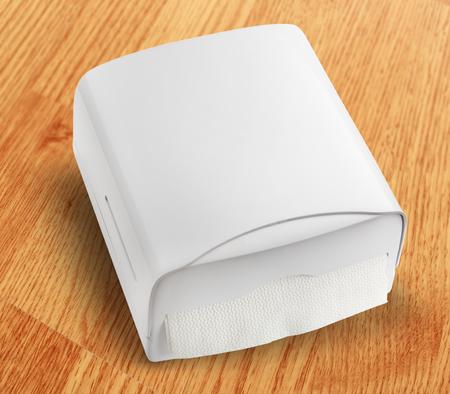 white towel: New white towel dispenser closeup and blank Stock Photo
