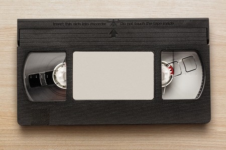 vcr: Black video cassette on the wooden background
