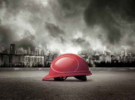 protective: Helmet on view of city in stormy sky background Stock Photo