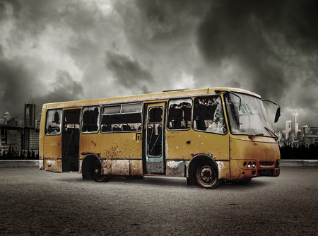 Broken bus on view of city in stormy sky background Stock Photo