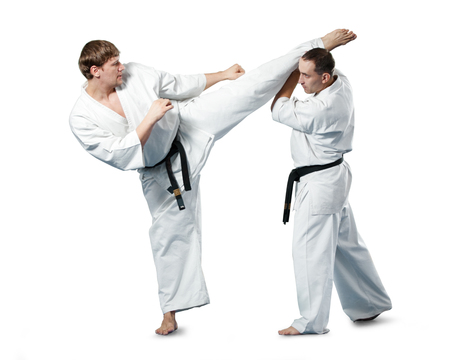 Karate fighters in action on white background 版權商用圖片
