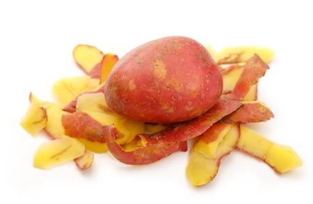 Fresh potato and peels on white background Stock Photo