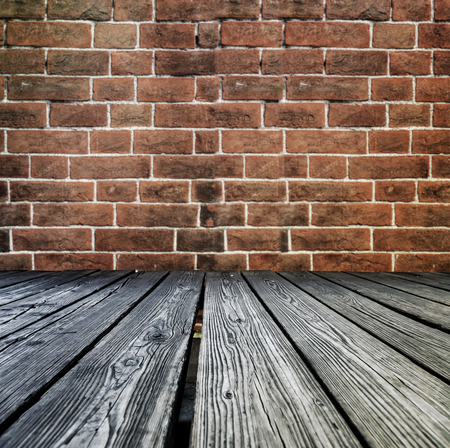 Rostrum made of wooden planks on brick wall background Stock Photo
