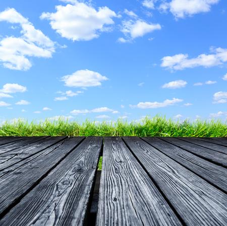 rostrum: Rostrum of wooden planks on blue sky background