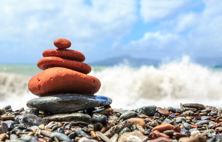quietness: Seashore with stone construction on blue sky background in closeup Stock Photo