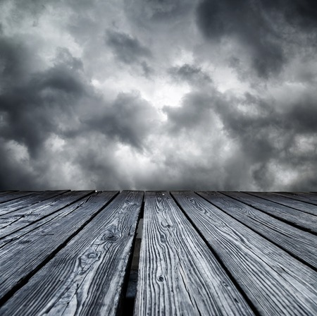 rostrum: Rostrum made of wooden planks on stormy sky background Stock Photo