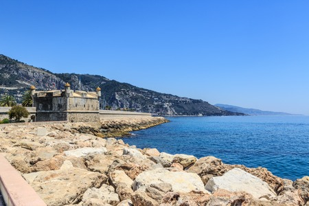heritage protection: Stone fortress museum along seashore in Menton