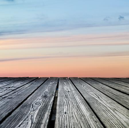 rostrum: Rostrum made of wooden planks on sunset background