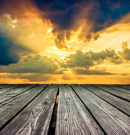 rostrum: Rostrum made of wooden planks on sky before sunset background