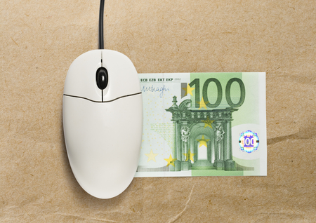 scrollwheel: Computer mouse and one hundred euro banknote on paper Stock Photo