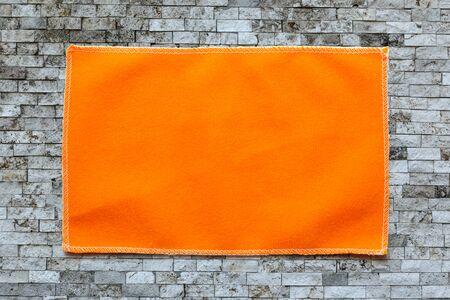 microfiber: Orange microfiber cloth for glasses in closeup Stock Photo