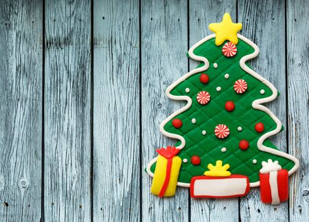 desk toy: Christmas decorative tree on the wooden background Stock Photo
