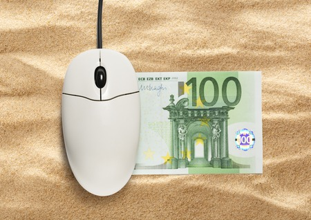 scrollwheel: Computer mouse and one hundred euro banknote on sand