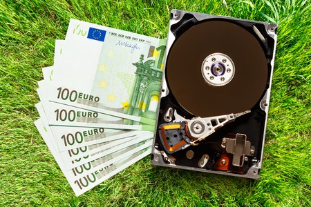 reconstruct: One hundred euro banknotes and hardisk in closeup Stock Photo