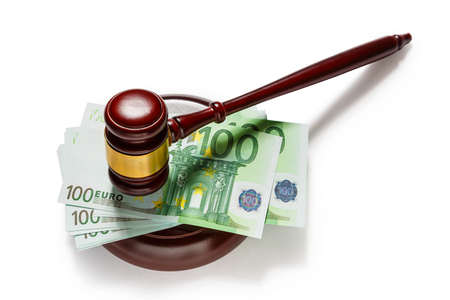 Wooden judges gavel and one hundred euro banknotes Stock Photo