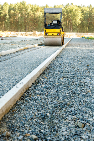 asphalting: Road roller working at road construction site Stock Photo