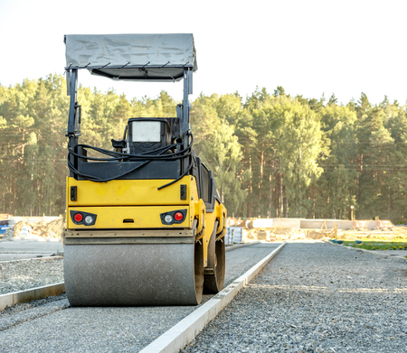 roller compactor: Road roller working at road construction site Stock Photo