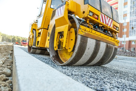 vibration machine: Road roller working at road construction site Stock Photo