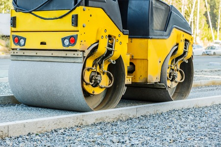 Road roller working at road construction site Stock Photo