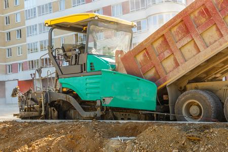 vibration machine: Asphalt-placing machine working on the city road Stock Photo