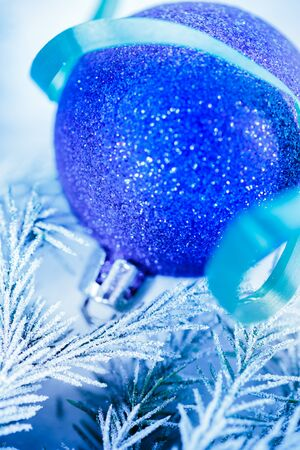 Christmas background with snow, toy and firtree branch