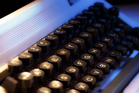 Keyboard of typewriter in blue toning Stock Photo