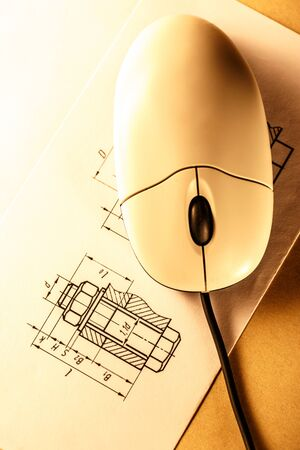 Drafting and computer mouse in toning closeup