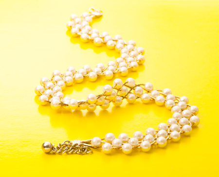 Necklace with golden chain and white beads Stock Photo