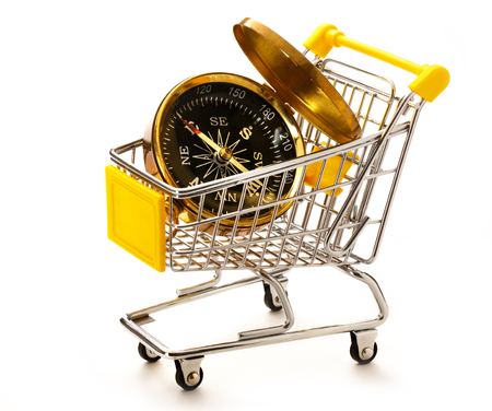 Market pushcart with compass on white background closeup Stock Photo