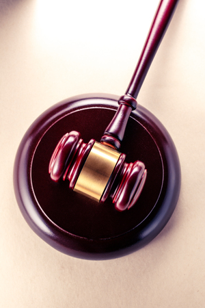 Wooden gavel and block closeup in toning Stock Photo
