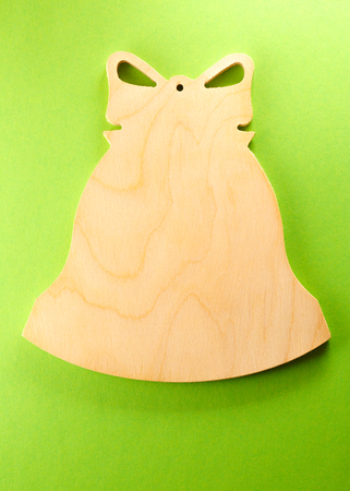 Blank wooden cutting board in bell form