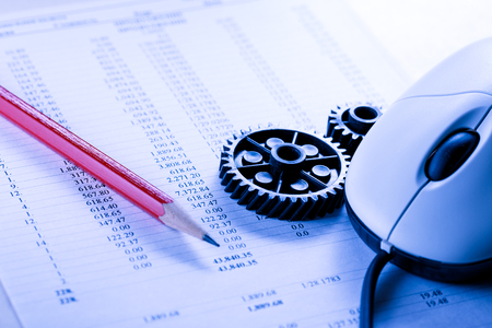 Mechanical ratchets, mouse, pencil and budget closeup Stock Photo