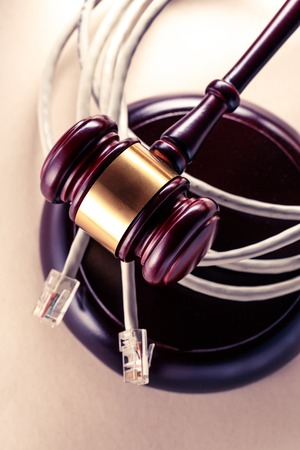 Computer cable and wooden gavel in toning Stock Photo