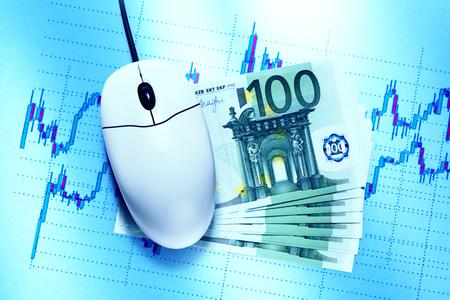 bullish market: Candle stick graph chart, mouse and euros