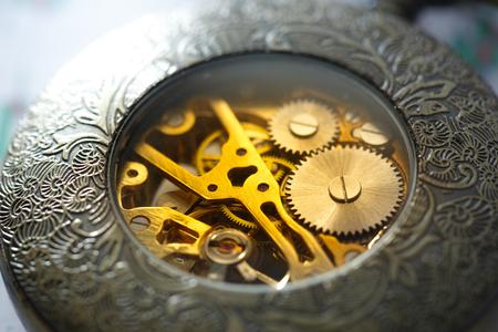 rackwheel: Metal inside mechanism of pocket watch in closeup