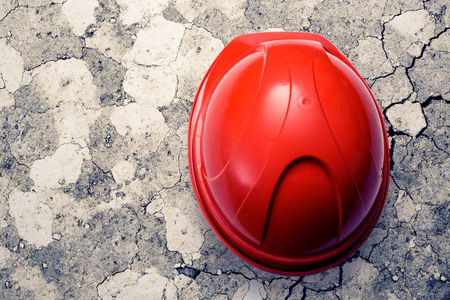 Red safety helmet from the top on ground