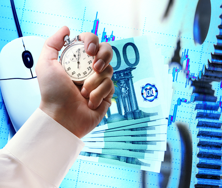 Computer mouse, euro and stopwatch in male hand Stock Photo