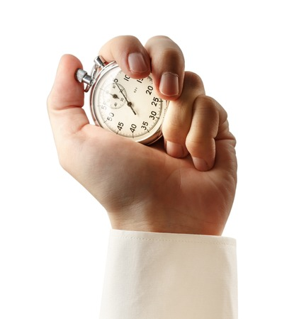 Stopwatch in male hand on white background Stock Photo