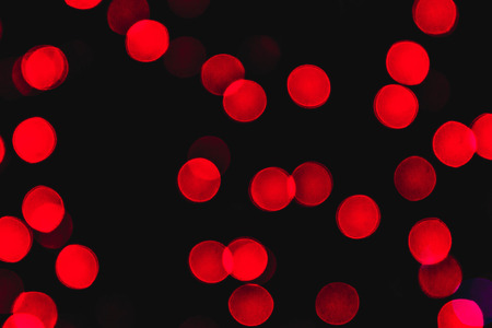 A variety of bokeh on a black background. Background of various unfocused glowing Christmas garlands. Stock Photo