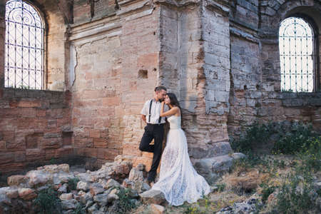 fiancee: Groom and fiancee in ancient building among ruins Stock Photo