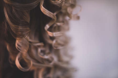ringlets: Ringlets of hair of the brunette close up. Background with place for your message