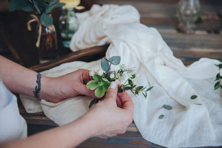 The preparation of the bonbonniere. Florist shop, wedding preparation.