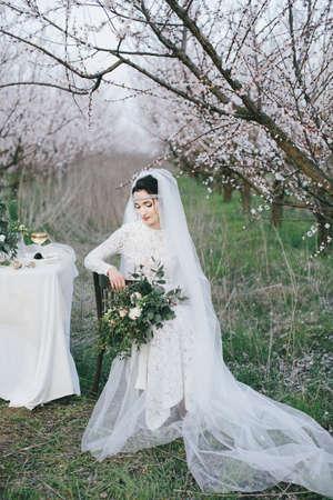 Beautiful bride sitting on a chair Banco de Imagens