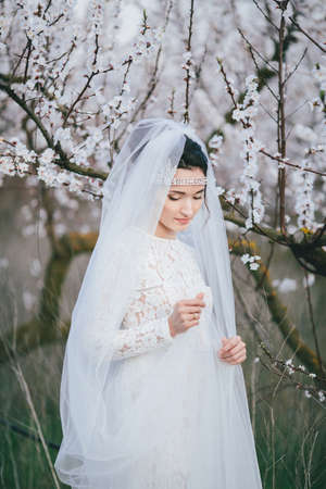 Portrait of the bride in blooming garden