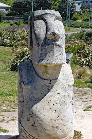 A Moai statue on the bank of Lyall Bay, Wellinton, New Zealand. This statue has been broken by vandals recently.